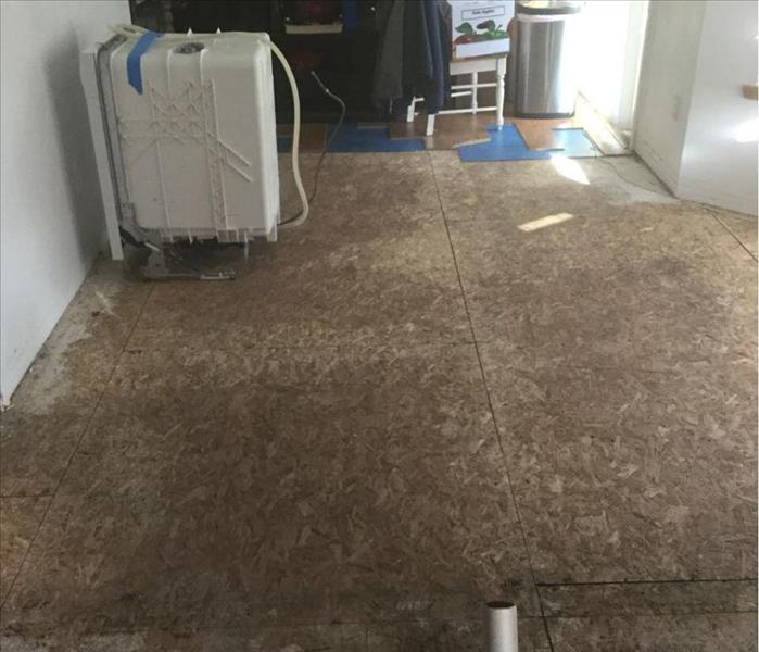 Water damage on the kitchen floor from flooding